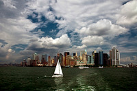 Manhattan with river and sailing boat