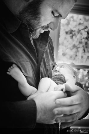 Los Altos newborn photographer - little Maeve with her family and her loving parents!